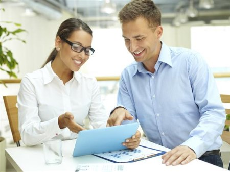 Couple Reviewing Assurance Abstract Paperwork